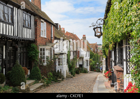 Famous narrow cobbled Mermaid Street with quaint old houses and inn in historic Cinque Port town of Rye East Sussex - Stock Photo