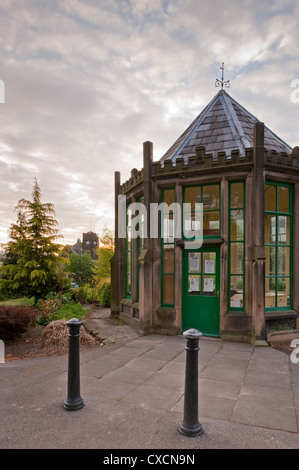 Close-up of The Round House (historic C19 octagonal gazebo) in beautiful, quiet, landscaped village park - Grange - Stock Photo