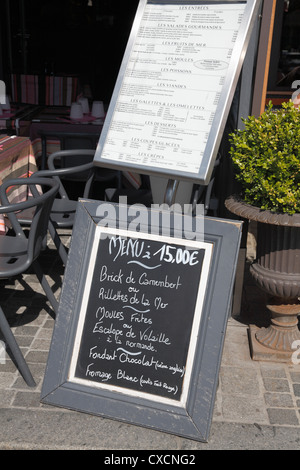 Seafood restaurant blackboard  15€ E Euro menus on quayside Deauville Normandy France - Stock Photo