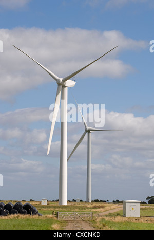 2 giant wind turbines (eyesore?) tower over farmland fields in scenic countryside - Knabs Ridge onshore wind farm, - Stock Photo
