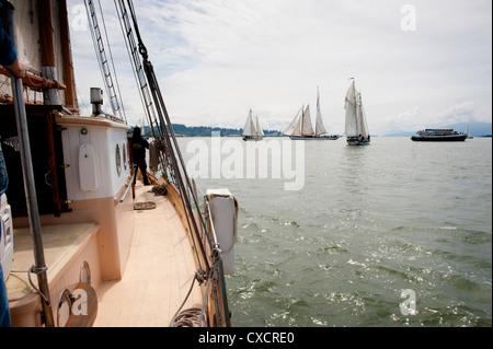 A schooner race on Bellingham Bay, Bellingham, Washington featuring vintage wooden sailboats under sail. - Stock Photo
