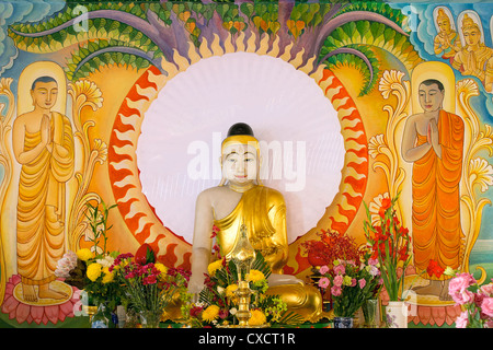 Enlightened Buddha Statue Sitting Under the Bodhi Tree with Painted Mural Background - Stock Photo