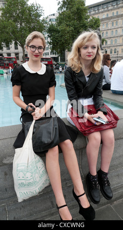 Teenage Girls In Retro Vintage Clothing Sitting By The Fountain Summer 2012 Trafalgar Square London