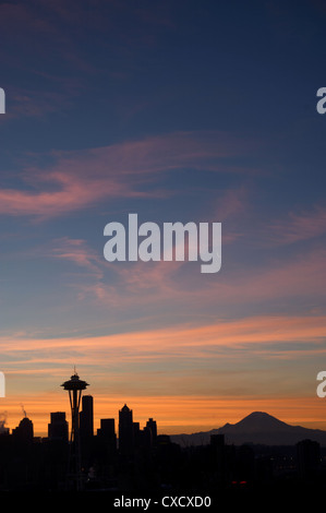 Silhouette of Seattle skyline with moon and Mount Rainier in distance, taken from Kerry Park, Seattle, Washington - Stock Photo