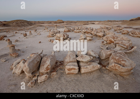 Rocks at the Egg Factory at dusk, Bisti Wilderness, New Mexico, United States of America, North America - Stock Photo