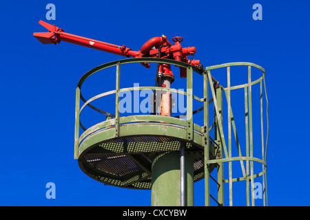Fire Hose / Nozzle at an oil / gas heavy industry plant - Stock Photo