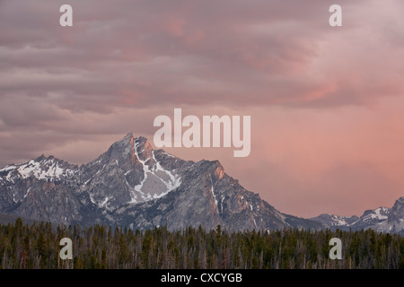 Pink clouds at sunset over The Sawtooth Mountains, Sawtooth National Recreation Area, Idaho, United States of America - Stock Photo