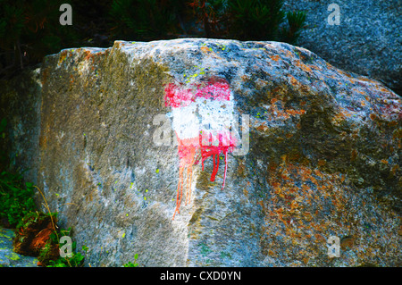Hiking trail marked on a rock Austria, Zillertal High Alpine nature Park Hochgebirgs Naturpark near Ginzling, Tyrol - Stock Photo
