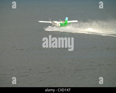 Seaplane makes a landing on a water - Stock Photo