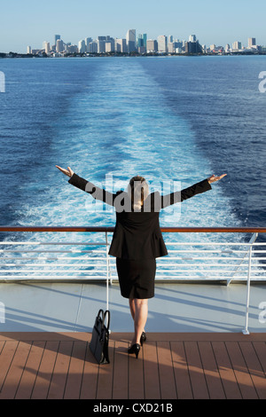 Business woman on a cruise ship, Nassau, Bahamas, West Indies, Caribbean, Central America - Stock Photo