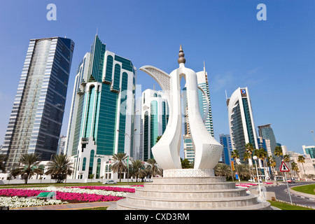 Coffee pot monument and the new skyline of the West Bay central financial district of Doha, Qatar, Middle East - Stock Photo