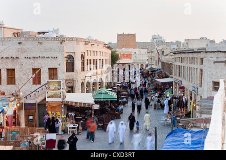The restored Souq Waqif with mud rendered shops and exposed timber beams, Doha, Qatar, Middle East - Stock Photo