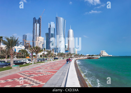 View along the Corniche towards the new skyline of the West Bay central financial district, Doha, Qatar, Middle - Stock Photo