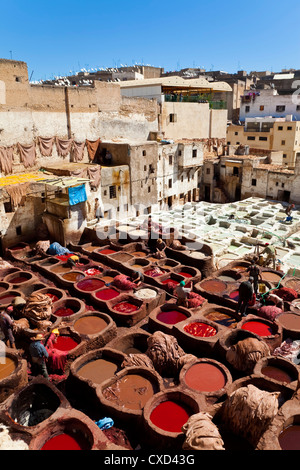 Chouwara traditional leather tannery in Old Fez, vats for tanning and dyeing leather hides and skins, Fez, Morocco, - Stock Photo