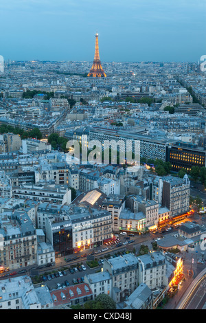 City and Eiffel Tower, viewed over rooftops, Paris, France, Europe - Stock Photo