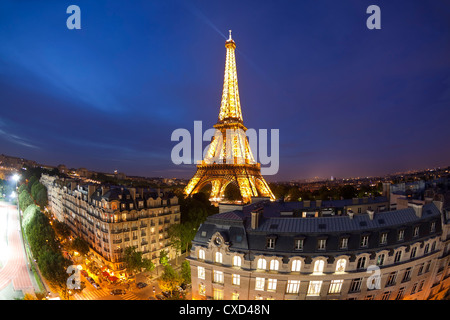 Eiffel Tower, viewed over rooftops, Paris, France, Europe - Stock Photo