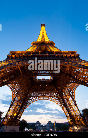 View upwards from underneath the Eiffel Tower, Paris, France, Europe - Stock Photo