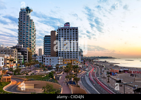 Elevated dusk view of the city beachfront, Tel Aviv, Israel, Middle East - Stock Photo