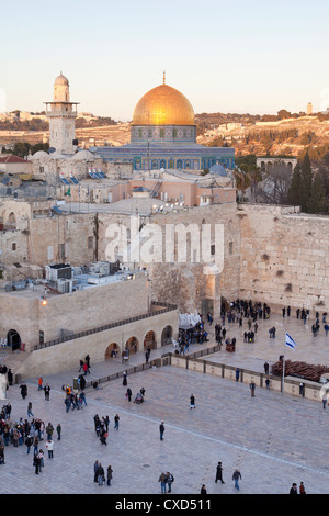 Jewish Quarter of the Western Wall Plaza with people praying at the Wailing Wall, Old City, Jerusalem, Israel - Stock Photo