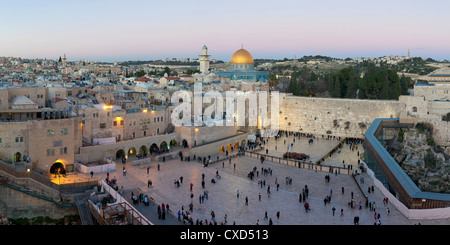 Jewish Quarter of the Western Wall Plaza, with people praying at the Wailing Wall, Old City, Jerusalem, Israel - Stock Photo