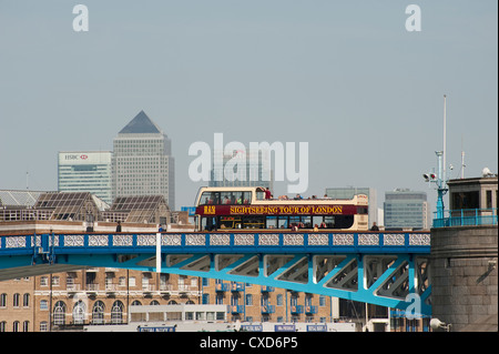 Open top sightseeing bus crossing Towers Bridge, City of London, England. - Stock Photo