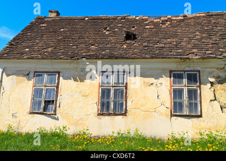 Abandoned old house (detail view) on sunny day - Stock Photo