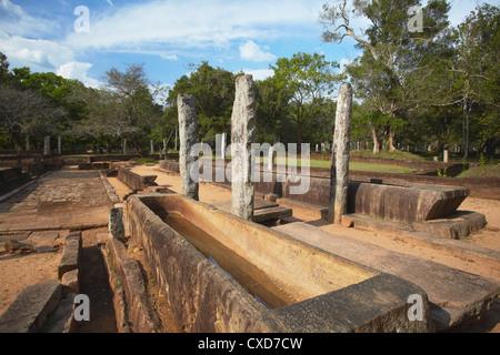 Rice trough inside remains of monastic refectory, Northern Ruins, Anuradhapura, North Central Province, Sri Lanka - Stock Photo