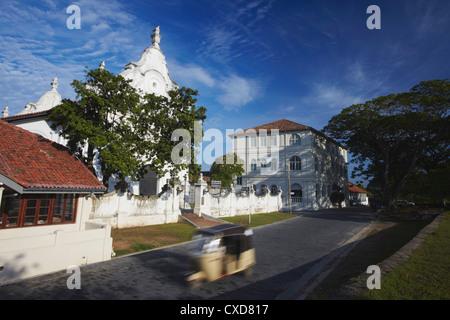 Tuk tuk passing Dutch Reformed Church, Galle, Southern Province, Sri Lanka, Asia - Stock Photo