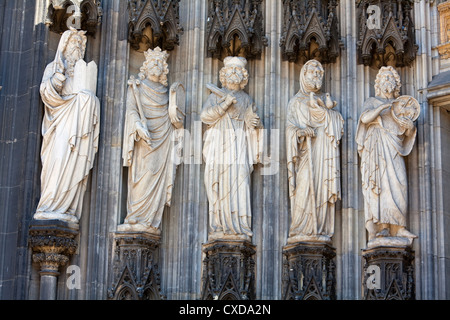 Limestone figures of an Apostle on the main portal, Koelner Dom, Cologne Cathedral, Germany, Europe - Stock Photo