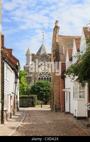 View along narrow cobbled street to St Mary's parish church in the historic town of Rye, East Sussex, England, UK, - Stock Photo