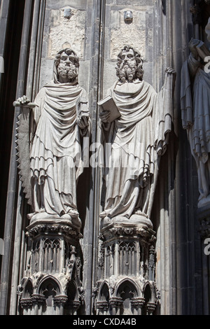 Limestone figures of an Apostle on the main portal, west façade, Cologne Cathedral, Germany, Europe - Stock Photo