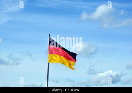 German flag in blue sky Berlin Germany - Stock Photo