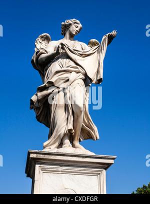 One of Bernini's Angels on the Ponte Sant'Angelo, the bridge across the Tiber to Castel Sant'Angelo, Rome, Italy. - Stock Photo