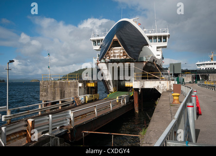 The Caledonian Macbrain Car Ferry Lord Of The Isles Docked In Oban Argyll and Bute Scotland With Bow Doors Open - Stock Photo