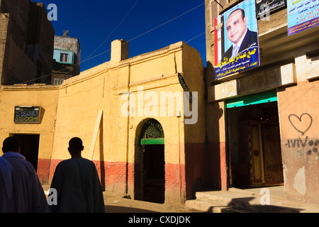 Street scene with electoral campaign poster and heart graffiti in rural Egypt. - Stock Photo