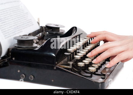 Woman hands typing on vintage typewriter isolated on white - Stock Photo