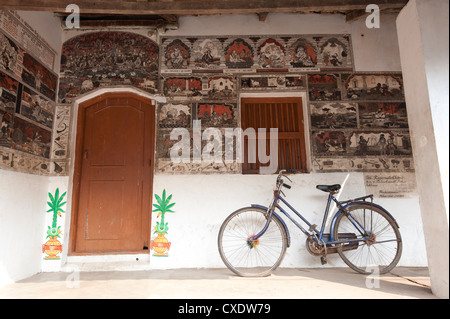 Ornately hand painted wall of artist's house depicting typical Orissan style of work in artists village of Raghurajpur, - Stock Photo