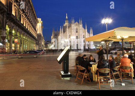 Restaurant in Piazza Duomo at dusk, Milan, Lombardy, Italy, Europe - Stock Photo