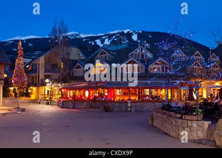 Village Square, Whistler VIllage at dusk, Whistler Blackcomb Ski Resort, Whistler, British Columbia, Canada, North - Stock Photo