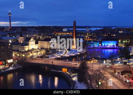 River Tammerkoski runs through the city centre, past the Finlayson Complex, night time in Tampere, Pirkanmaa, Finland - Stock Photo