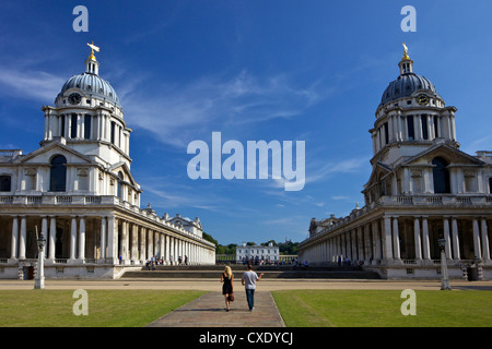 Visitors enjoy summer sunshine, Old Royal Naval College, built by Sir Christopher Wren, Greenwich, London - Stock Photo
