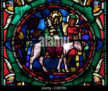 Medieval stained glass depicting Mary, baby Jesus and Joseph on a donkey, Canterbury Cathedral, Canterbury, Kent - Stock Photo