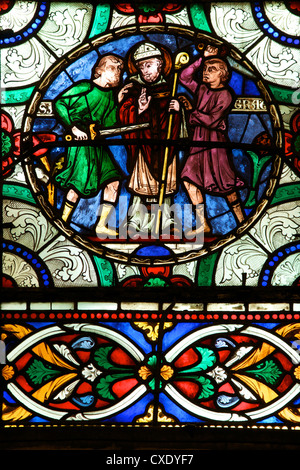 Medieval stained glass depicting the Murder of St. Thomas a Becket, Canterbury Cathedral, Canterbury, Kent - Stock Photo