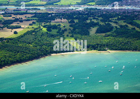 Aerial view of yachts racing in Cowes Week on the Solent, with Osborne House in background, Isle of Wight, England - Stock Photo