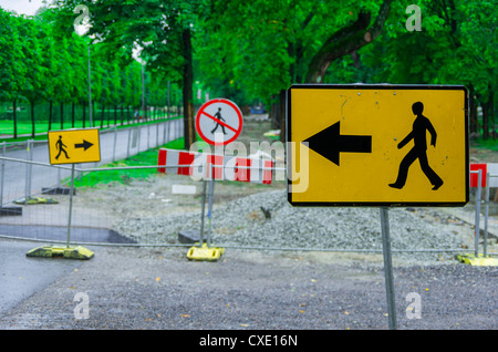 Follow left-right and no way signs - Stock Photo