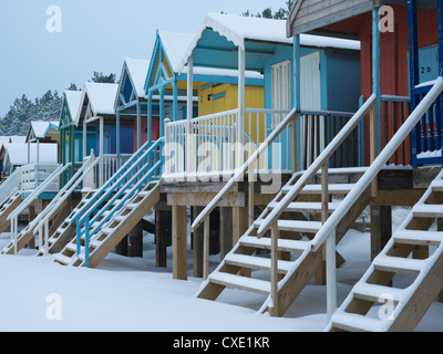 Beach huts in the snow at Wells next the Sea, Norfolk, England - Stock Photo