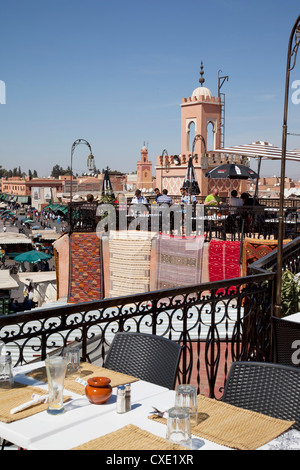 Rooftop terrace and minarets, Place Jemaa El Fna, Marrakesh, Morocco, North Africa, Africa - Stock Photo
