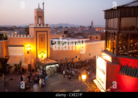 Mosque at dusk, Place Jemaa El Fna, Marrakesh, Morocco, North Africa, Africa - Stock Photo