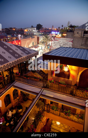 View over rooftops at dusk, Marrakesh, Morocco, North Africa, Africa - Stock Photo