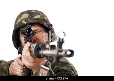 Soldier aiming a rifle - Stock Photo